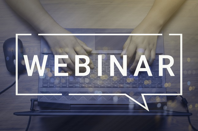 Typing on a computer with webinar caption.