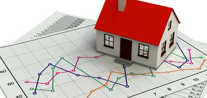 Housing market graph with small model home.