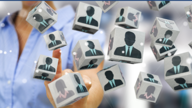 Candidate blocks with women and men in suits on faces of them.